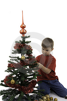 Small Boy Decorate A New Year Tree Royalty Free Stock Images - Image: 16392529