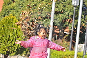 A Girl Play With Dry Leaves Stock Images - Image: 16396874