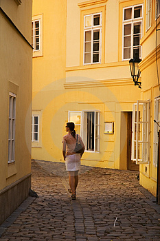 Girl Walking Between Yellow Buildings Royalty Free Stock Image - Image: 1643816