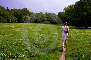 Girl Walking Through Meadow Royalty Free Stock Photography - Image: 1643907