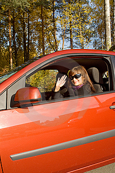 The Girl In The Red Car Stock Photos - Image: 16429153