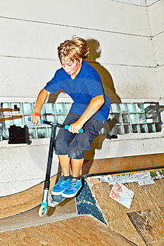 Boy Goes Airborne With His Scooter Royalty Free Stock Photography - Image: 16442637