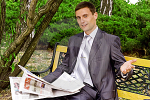 Young Businessman Reading A Newspaper Royalty Free Stock Photos - Image: 16442688