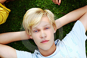 Young And Attractive Teenager Get Rest At Grass Royalty Free Stock Images - Image: 16450519