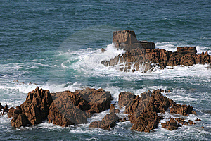 Rocks In The Sea Off The Coast Of Guernsey Stock Images - Image: 16453834