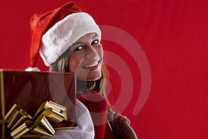 Smiling Santa Girl With Gifts Royalty Free Stock Images - Image: 16471309