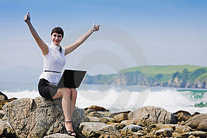 Funny Girl On The Rocky Shore Sits Royalty Free Stock Photography - Image: 16479127