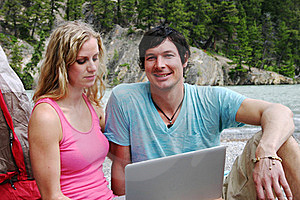 Couple Sitting With Computer Stock Photography - Image: 16485492