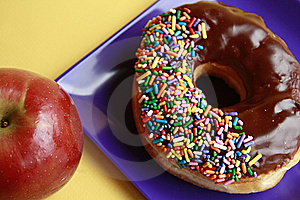 Chocolate Glazed Doughnut And Apple Stock Photo - Image: 16488990