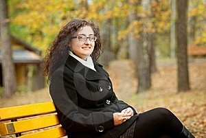 Smilling Woman Sitting On Bench Stock Image - Image: 16497771