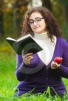 Woman Reads Book On Green Grass Stock Photography - Image: 16497992