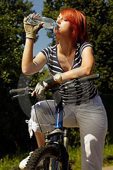 Young Adult Smiling Biker Woman On Mounting Bike Royalty Free Stock Photos - Image: 16501478