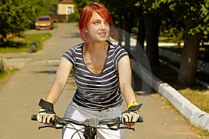 Young Adult Smiling Biker Woman On Mounting Bike Stock Photography - Image: 16501502