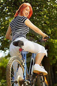 Young Adult Smiling Biker Woman On Mounting Bike Royalty Free Stock Image - Image: 16501546