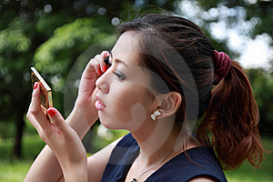 Pretty Young Woman Applying Mascara Stock Images - Image: 16511804