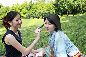 Beautiful Girls Helping Their Friend To Makeup Stock Photography - Image: 16511832
