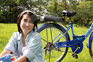 Woman With A Bike Outdoors Smiling Stock Images - Image: 16511974