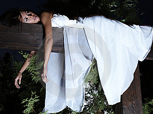 Attractive Suntanned Girl In White Dress Poses. Stock Images - Image: 16512354