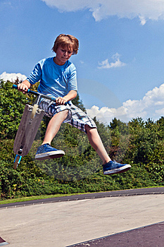 Young Boy Going Airborne With His Scooter Royalty Free Stock Photos - Image: 16523308