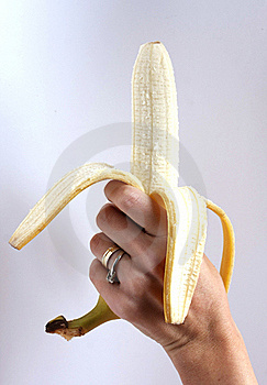 Peeled Banana Held In The Hand Stock Photography - Image: 16547182