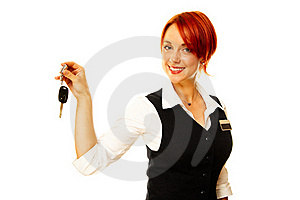 Caucasian Woman As Hotel Worker Offering Key Stock Images - Image: 16563914