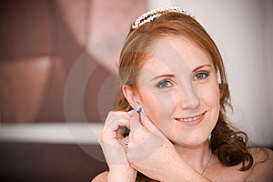Sexy Beautiful Bride Inserting Her Earrings Royalty Free Stock Photo - Image: 16564515