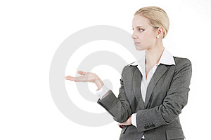 Businesswoman Presenting A Product Royalty Free Stock Image - Image: 16572666