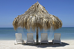 Four Chairs And Palapa Stock Photo - Image: 16584580