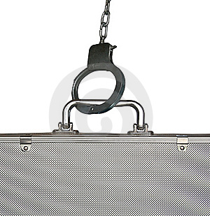 Handcuffs And Suitcase Royalty Free Stock Photography - Image: 16609877