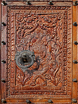 Relief Carved Wood With A Beautiful Metal Knocker Stock Photos - Image: 16628183