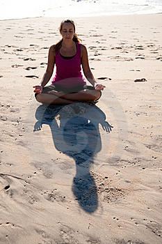 Woman Doing Yoga On Beach. Royalty Free Stock Image - Image: 16628806