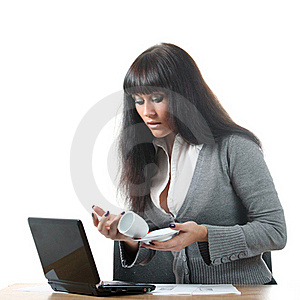 Girl Spill Coffe To The Notebook Stock Photo - Image: 16628910
