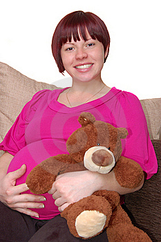 Happy Young Pregnant Woman Sitting On The Sofa Stock Photo - Image: 16638150