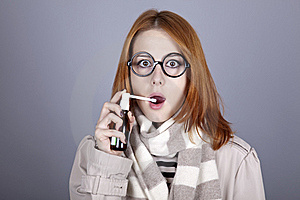 Chill Red-haired Girl In Glasses With Spray. Stock Photography - Image: 16639192