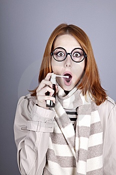 Chill Red-haired Girl In Glasses With Spray. Stock Image - Image: 16639201