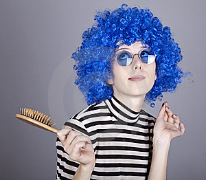 Coquette Blue-hair Girl With Comb. Royalty Free Stock Photos - Image: 16639648