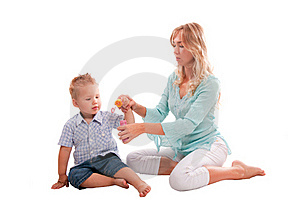 Mother With Joyful Son Playing With Soap Bubbl Stock Image - Image: 16640961