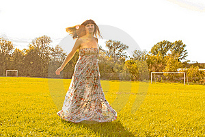 Girl Spinning By Sunset In The Field Stock Photos - Image: 16668743