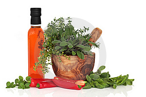 Chillies, Oil And Herb Leaves Royalty Free Stock Photography - Image: 16690337