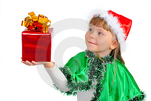 The Girl In A Xmas Suit With A Gift Royalty Free Stock Image - Image: 16692286