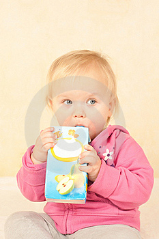 Cute Toddler Girl Sit And Drinking Juice Royalty Free Stock Photos - Image: 16698968