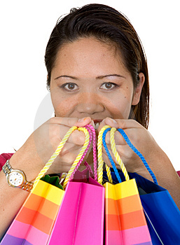 Asian girl with shopping bags Stock Photos
