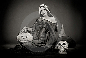 Halloween Witch With A Skull And Pumpkin Royalty Free Stock Photography - Image: 16702047