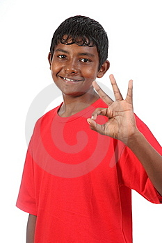 OK Signal By Young Smiling Teenager Boy In Studio Royalty Free Stock Images - Image: 16702889