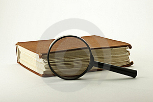 Old Book With Magnifying Glass Royalty Free Stock Photo - Image: 16718935