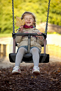 Little Happy Girl On The Swing Royalty Free Stock Images - Image: 16724139