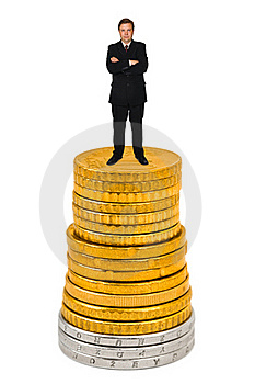 Businessman On Money Stack Stock Photos - Image: 16738393