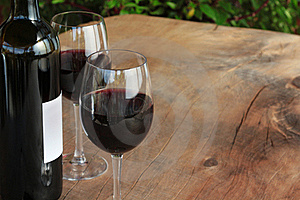 Red Wine On Outdoor Wooden Table Stock Images - Image: 16749614