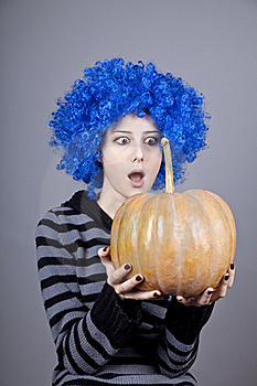 Funny Girl With Blue Hair Keeping Pumpkin. Stock Images - Image: 16752614