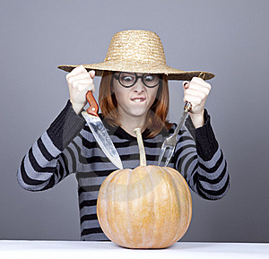 Funny Girl In Cap Try To Eat A Pumpkin. Royalty Free Stock Images - Image: 16752719